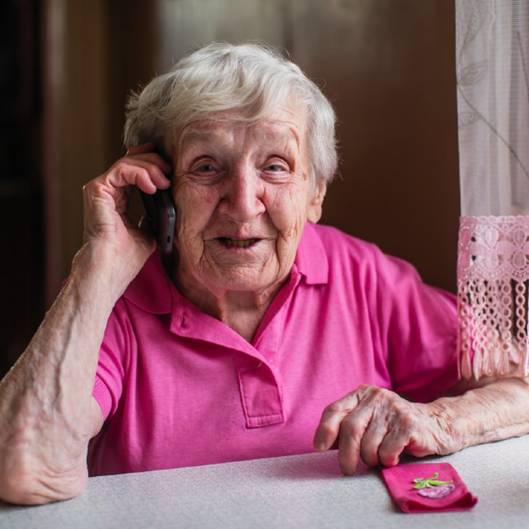 Elderly woman on mobile phone